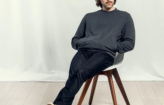Man sitting in chair wearing Charcoal Hybrid Crew Neck Sweatshirt