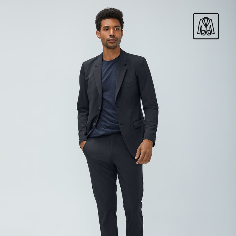 Man wearing black Velocity suit and blue composite tee