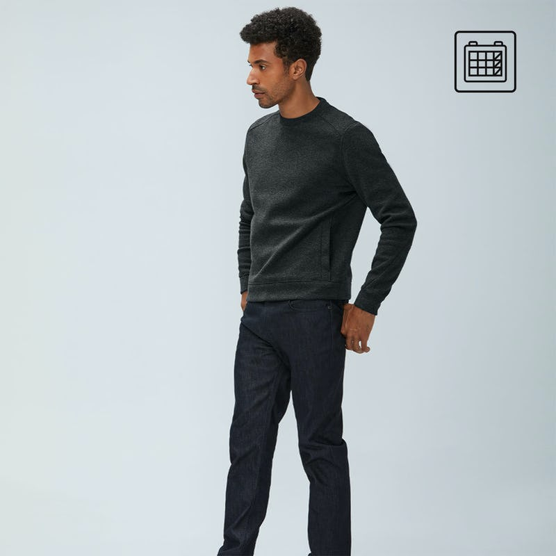 Man wearing grey Hybrid sweatshirt and chroma denim jeans