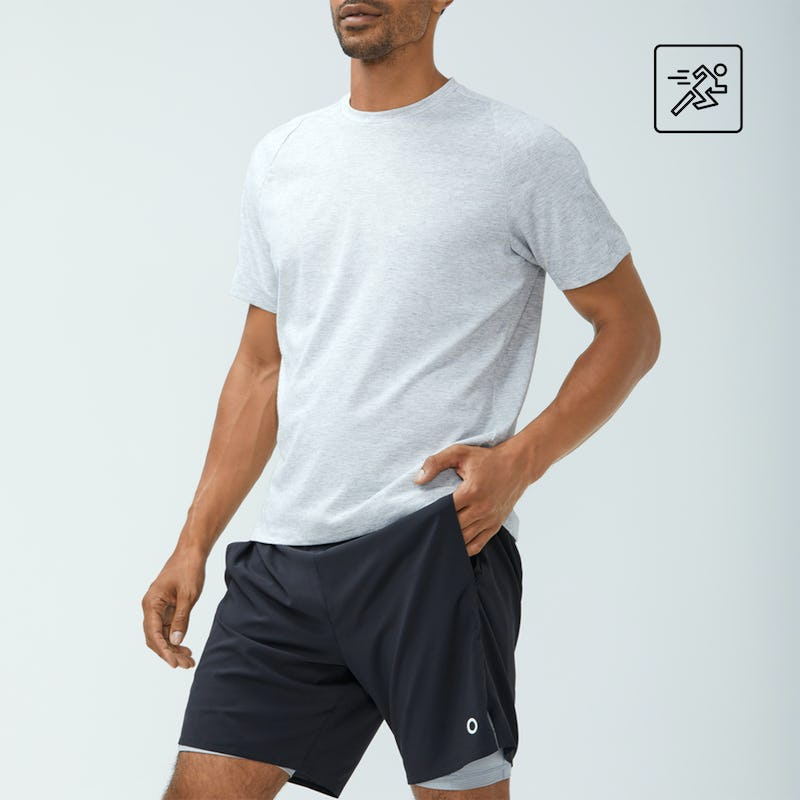 Man wearing composite tee and newton active shorts