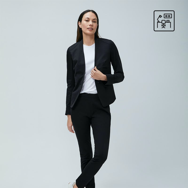 Woman wearing black Kinetic suit and white tee shirt