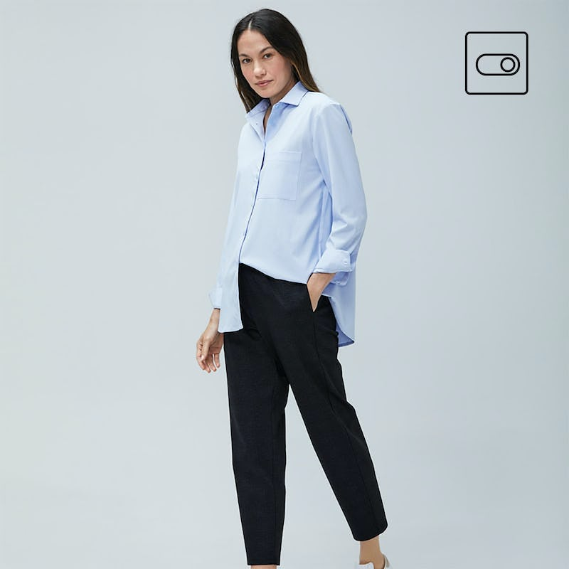 Woman wearing blue Apollo boyfriend shirt and Fusion pull on pants