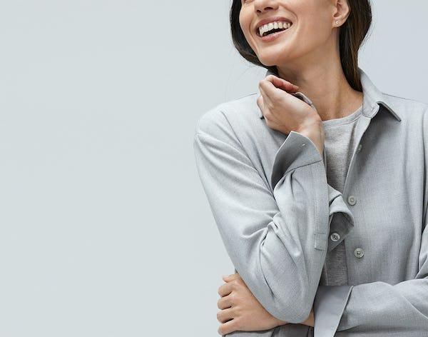Woman wearing grey fusion overshirt