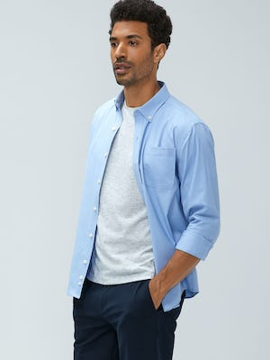 men's chambray mini grid aero button down and men's light grey composite merino tee model with hands in pockets