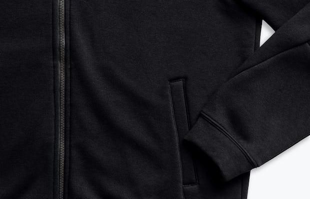 men's black hybrid full zip hoodie zoomed shot of cuff, pocket and zipper