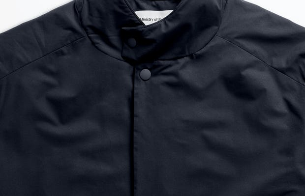 men's navy kinetic light layer zoomed shot of collar buttoned up