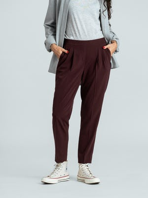 women's deep ruby swift drape pant close up of model facing forward with hands in pockets