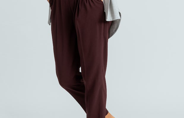 women's deep ruby swift drape pant close up of model with hands in pockets
