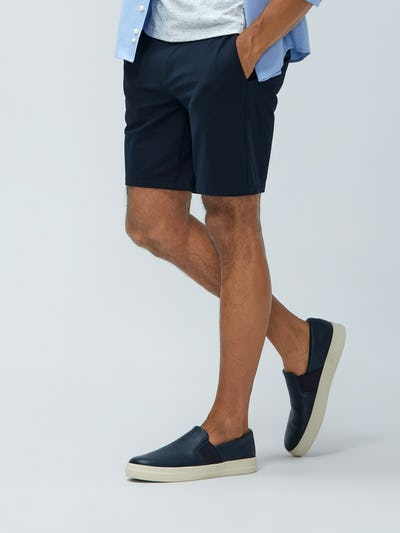 Close up of Men's Navy Kinetic shorts on model