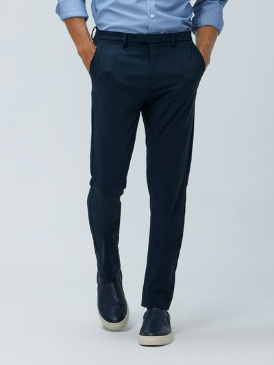 Close up of Men's Dark Navy Velocity Pant on model