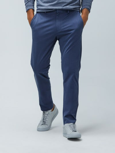 Men's Indigo Heather Kinetic Pants on Model walking forward with hands in pockets