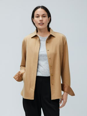 women's camel fusion overshirt unbuttoned model facing forward with hand in pocket