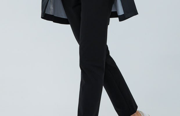 Women's Black Kinetic Slim Pant on Model walking forward with hand in pocket