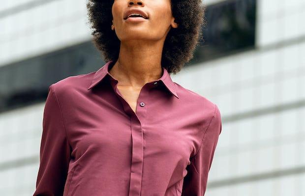 women's deep garnet juno blouse close up of model facing forward hands in pockets
