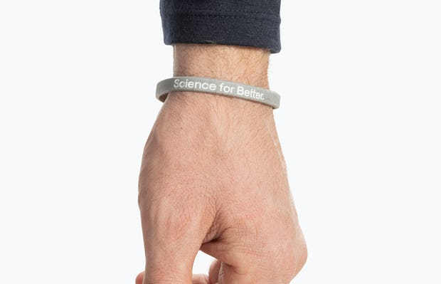 grey science for better vaccine awareness bracelet on wrist showing the science for better side