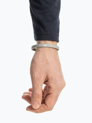 grey science for better vaccine awareness bracelet on wrist showing the M° logo