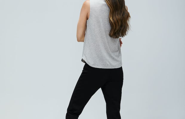 Women's Grey Heather Recycled Composite Merino Tank and Women's Black Fusion Straight Leg Pant on Model Facing backwards