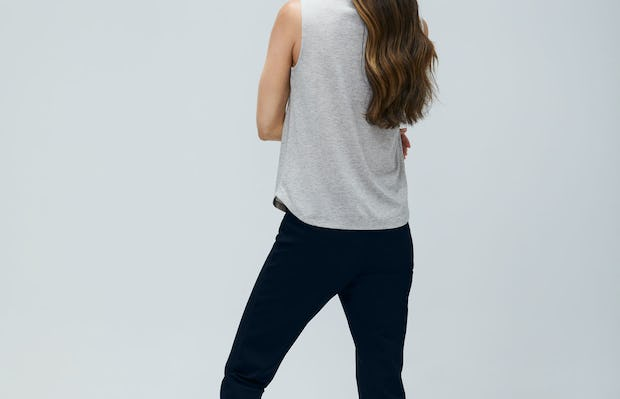 Women's Grey Heather Recycled Composite Merino Tank and Women's Navy Fusion Straight Leg Pant on Model Facing backwards