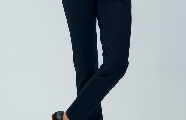 Women's Black Juno Patch Pocket and Women's Navy Fusion Straight Leg Pant zoomed Model facing forward with crossed legs