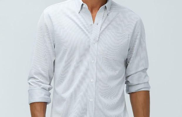 men's grey heather stripe hybrid button down model facing forward sleeves cuffed