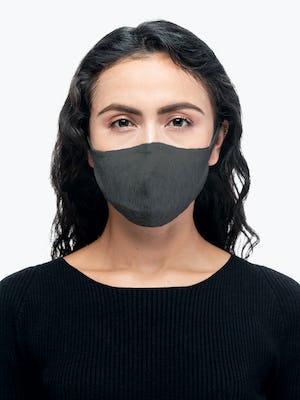 model wearing medium grey 3d print knit mask 2.0 facing forward
