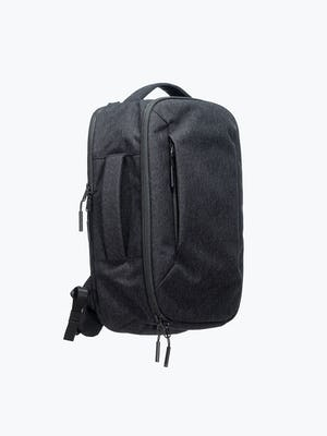 black aer lunar pack shot of front and side showing brief carry handle