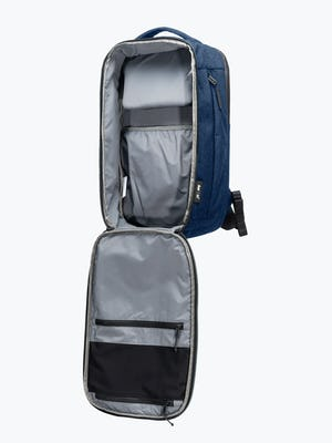 navy aer lunar pack shot of front at an angle unzipped showing side inner compartments