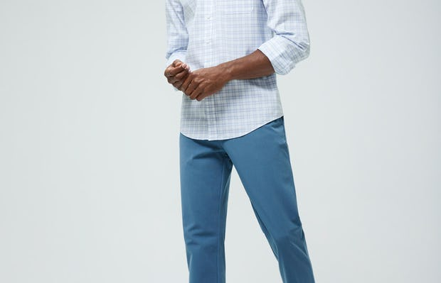 Men's Blue Dot Matrix Aero Button Down and Men's Storm Blue Momentum Chino on model walking left