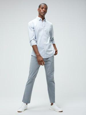 Men's Blue Grey Tattersall Aero Button Down and Men's Light Grey Momentum Chino on model facing forward