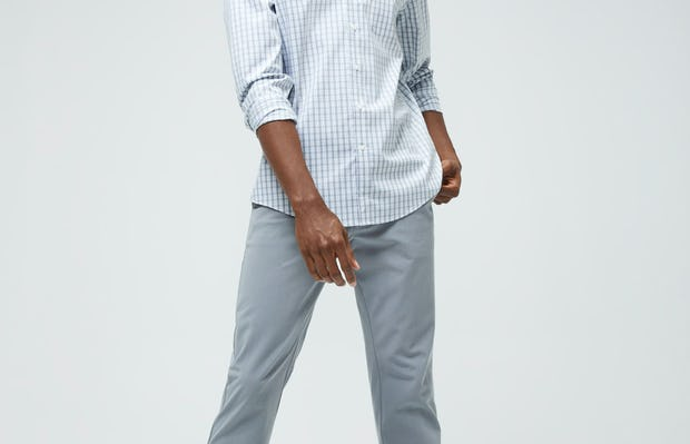Men's Blue Grey Tattersall Aero Button Down and Men's Light Grey Momentum Chino on model facing forward