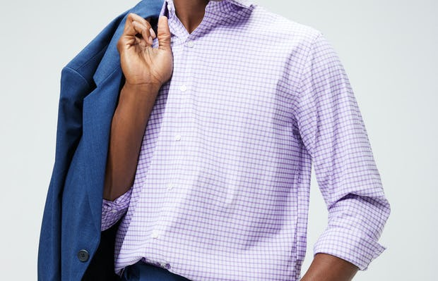 Men's Lavender Quad Grid Aero Shirt on Model carrying Men's Indigo Heather Velocity Blazer over shoulder