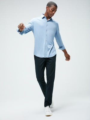 Men's Deep Sky Blue Oxford Apollo Brushed Shirt and Men's Navy Kinetic Pant on Model with arms raised
