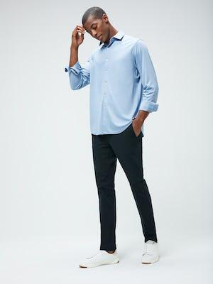 Men's Deep Sky Blue Oxford Apollo Brushed Shirt and Men's Navy Kinetic Pant on model walking left
