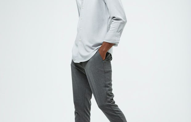 Men's Grey White Heather Apollo Brushed Shirt and Men's Graphite Velocity Tapered Pant on model walking left