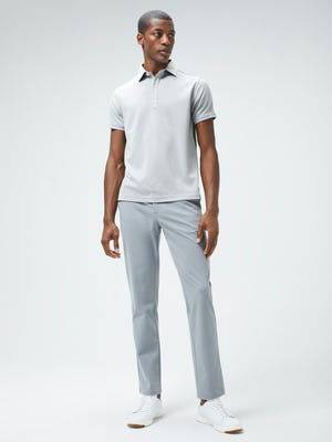 Men's Grey White Heather Apollo Polo and Men's Light Grey Momentum Chino on model facing forward
