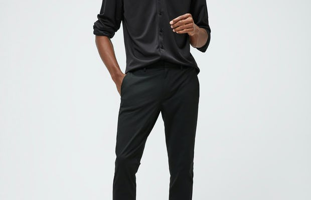 Men's Black Recycled Apollo Shirt and Men's Black Kinetic Tapered Pant on Model facing forward