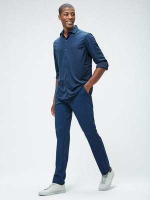 Men's Navy Recycled Apollo Shirt and Men's Indigo Heather Velocity Pant on model walking left