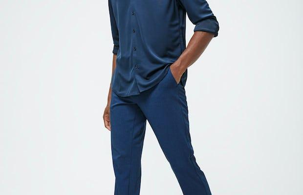 Men's Navy Recycled Apollo Shirt and Men's Indigo Heather Velocity Pant on model walking left