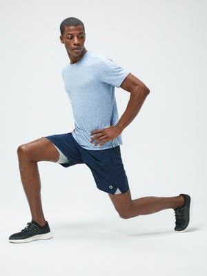 Men's Chambray Blue Composite Merino Active Tee and Men's Navy Newton Active Shorts on model lunging to the left