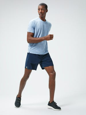 Men's Chambray Blue Composite Merino Active Tee and Men's Navy Newton Active Shorts on model running right