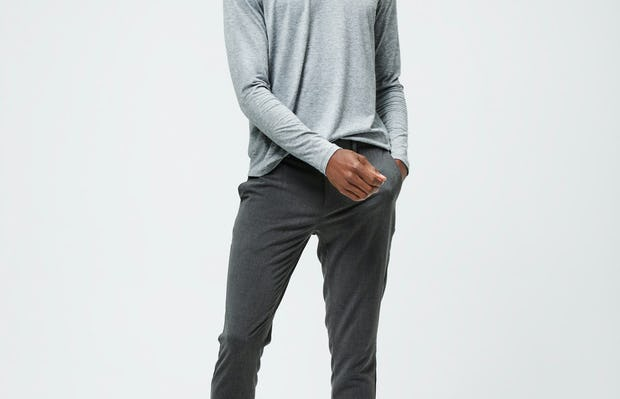 Men's Charcoal Grey Heather Composite Merino Long Sleeve Tee and Men's Graphite Velocity Tapered Pant on model facing forward