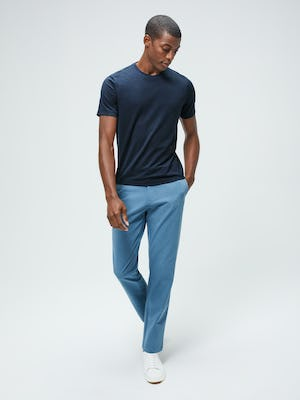 Men's Navy Composite Merino Tee and Men's Storm Blue Momentum Chino on model walking forward