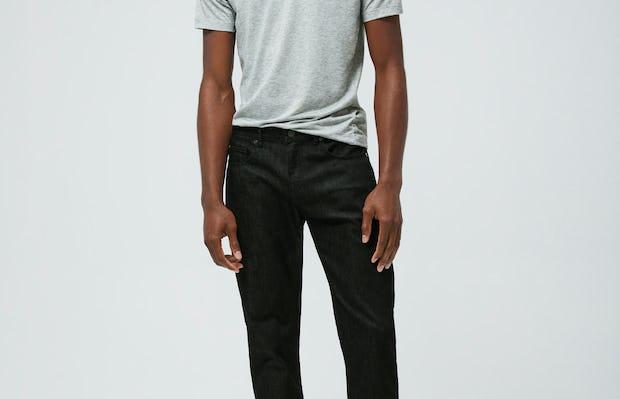 Men's Pale Grey Heather Composite Merino Tee and Men's Black Chroma Denim on Model facing forward