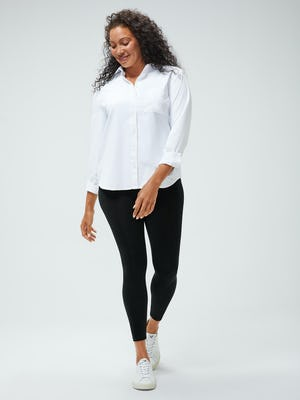 Women's White Aero Zero Boyfriend Shirt and Women's Black Joule Active Legging on model walking forward