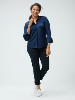 Women's Navy Apollo Shirt and Women's Navy Kinetic Pull-On Pant on model facing forward