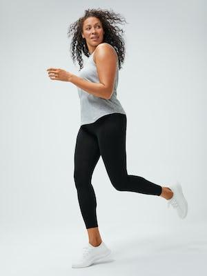 women's pale grey heather composite merino active tank and black joule active legging model running left