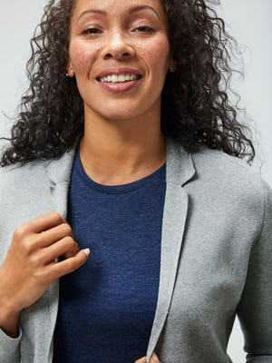 women's navy composite merino tank and light grey atlas knit blazer close up of model with hand on lapel