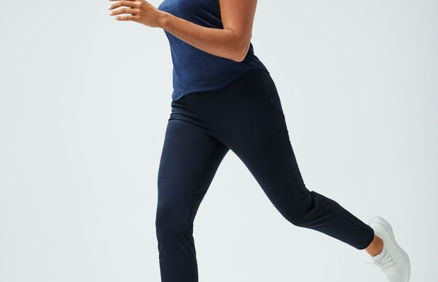 women's navy composite merino tank and navy fusion straight leg pant model running forward in sneakers