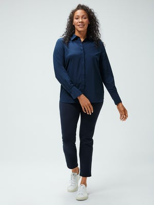 women's navy juno blouse and navy fusion straight leg pant model stepping forward