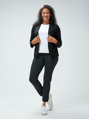 women's black kinetic blazer and white luxe touch tank and grey heather houndstooth fusion straight leg pant model facing forward with hands on lapels